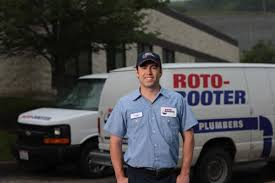 Male Plumber in front of van